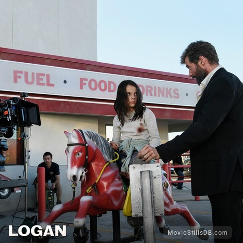 Logan - Behind the scenes photo of Hugh Jackman & Dafne Keen