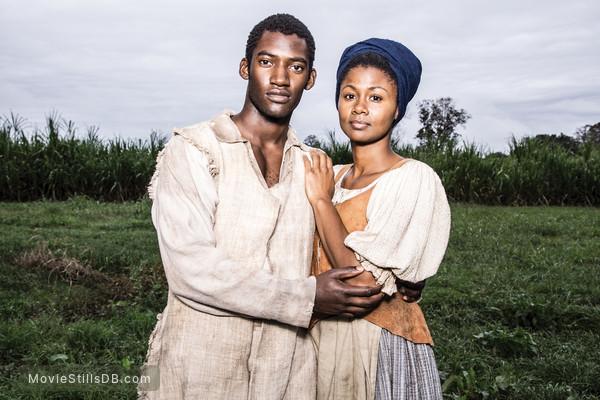 Roots - Promo shot of Malachi Kirby & Emayatzy Corinealdi