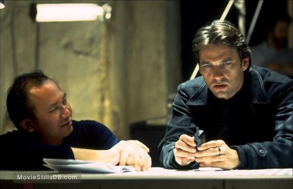 Mission: Impossible II - Behind the scenes photo of John Woo & Dougray Scott