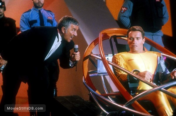 The Running Man - Publicity still of Arnold Schwarzenegger & Richard Dawson