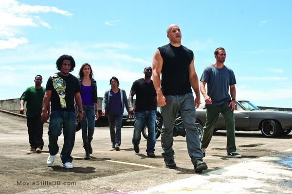 Fast Five - Publicity still of Vin Diesel, Paul Walker, Sung Kang, Tyrese Gibson, Tego Calderón, Don Omar & Gal Gadot