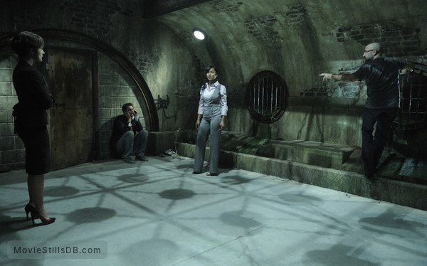 Saw V - Publicity still of Meagan Good, Carlo Rota, Greg Bryk & Julie Benz