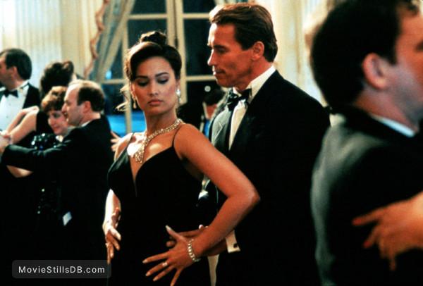 True Lies - Publicity still of Arnold Schwarzenegger & Tia Carrere