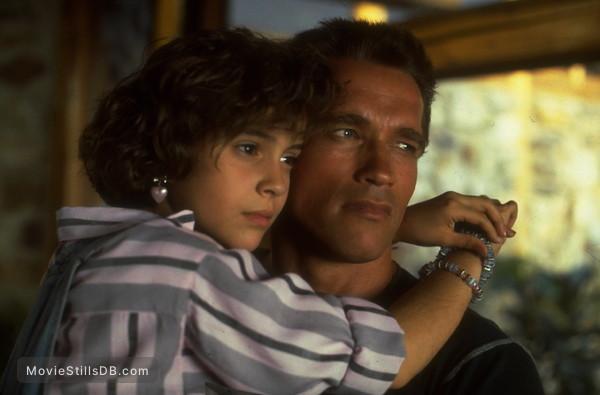 Commando - Publicity still of Arnold Schwarzenegger & Alyssa Milano