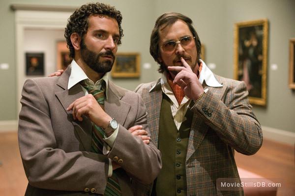 American Hustle - Publicity still of Christian Bale & Bradley Cooper