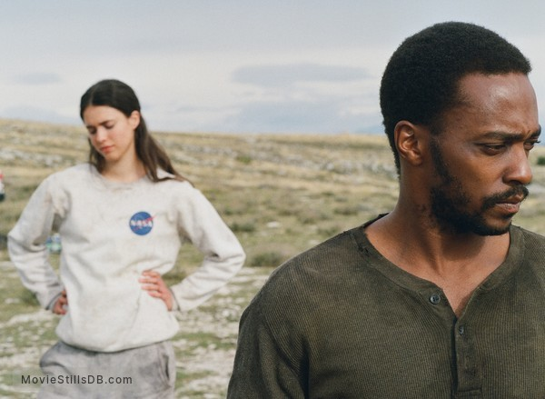 IO - Publicity still of Anthony Mackie & Margaret Qualley